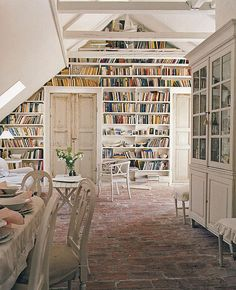 Oh my lord. Exposed beams, distressed wood, and sooo many books. My dream room.