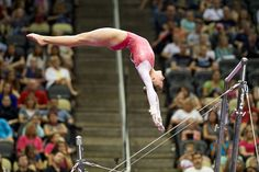 Madison Desch (United States) on uneven bars at the 2014 P&G Championships