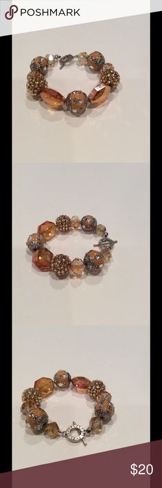 Shades of peach bracelet A variety of beads with shades of peach. Silver metal toggle. Handmade Jewelry Bracelets