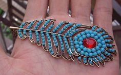 vintage style beautiful peacock feathers necklace, made with blue beads and red crystal. $2.00, via Etsy.