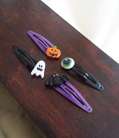 Halloween hair clips decorated with polymer clay, black and purple hair clips, Halloween hair clip collection, ghost, bat, pumpkin, eye Halloween Hair Clips, Halloween Queen, Polymer Clay Creations, A Pumpkin, Purple Hair, Purple And Black, Halloween Decorations, Wordpress, My Etsy Shop