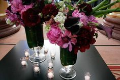 A beautiful centerpiece with shades of purples and pinks including lillies, orchids, peonies and hydrangeas.