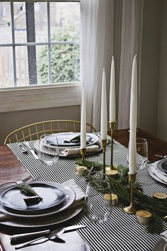 Black and white stripe runner, gold candlestick holders. A Very Scandinavian Christmas: Holiday Home Tour!