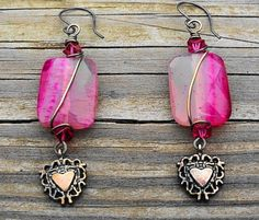 SOLD - 23 X 20mm light to dark fuchsia agate faceted pillows, a couple of oxidized silver toned fancy heart charms and fuchsia cubed glass beads create a somewhat different take on a Valentine