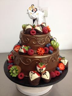 Chocolate truffle wedding cake with chocolate strawberries