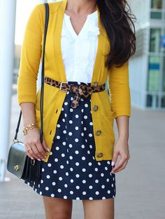 Mustard cardi and navy polka dot skirt accented with a leopard belt. Pretty combo!