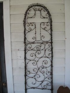 trellis with cross and scroll approx. 14 inches wide x 54 inches tall barbed wire and rebar