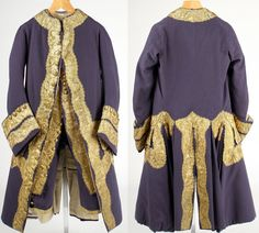 Suit (frockcoat, waistcoat and breeches), 1760s, England, wool, metal, gilt. Skintight breeches that buckle below the knee and a fitted waistcoat are almost entirely covered by a coat with collarless, narrow chest and stiffly flaring skirt that concentrates emphasis on the lower torso and thighs. The placement of the opulent applied decoration bolsters this effect.  The Met.