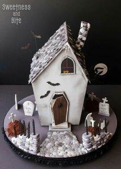 Awesome Halloween haunted house cake by Sweetness and Bite!