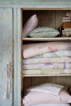 Oh to have a cupboard of soft, vintage quilts.
