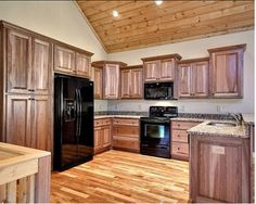Kitchen with wood floors and wood cabinetry