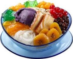 Halo Halo - a popular Filipino dessert with mixtures of shaved ice and evaporated milk to which are added various boiled sweet beans, jello, fruits and ice cream.
