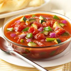 Summer Tomato Vegetable Soup: A quick no cook soup of diced tomatoes with zucchini, bell pepper and red onion 'freshened' with lemon juice Tomato Vegetable, Vegetable Soup Recipes, Veggie Soup, Easy Soup Recipes, Vegetarian Recipes, Cooking Recipes, Healthy Recipes, Healthy Food, Healthy Eating