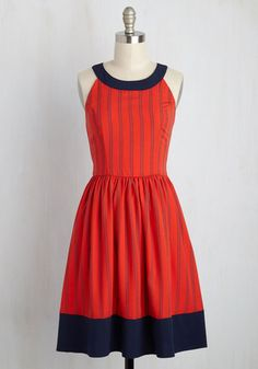 For an in-house dance party or outdoor adventure with your sweetie, this red dress is the ideal ensemble! From its rounded contrast collar to its colorblocked hem, this tie-back frock - flaunting illusory navy stripes - provides endless possibilities for fun romance.