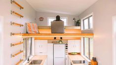New Zealand–based tiny house company Build Tiny used clever storage solutions to maximize space in this home.The Millennial Tiny House is a simple x residence with a dedicated office loft that can be accessed via a wall ladder. Tiny House Loft, Tiny House Swoon, Tiny House Storage, Tiny House Living, Tiny House Plans, Tiny House Design, Tiny House On Wheels, Home Design, Living Room