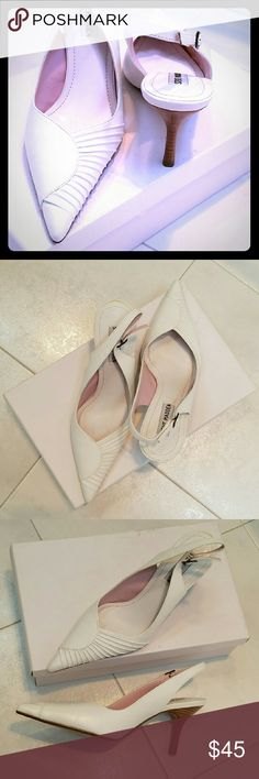 Shoes White, leather upper, sling back shoes with front detail and brown heel. 3 1/2 inch heel. Worn once. Steve Madden Shoes Heels