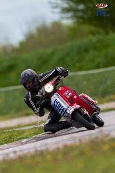 Who knew people races Vespas?  Very cool!    Vespa Racing