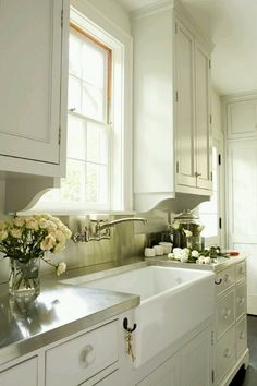 sink, wall mounted faucet, stainless counters