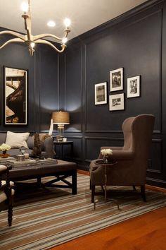 Darks walls, chair, frames, lighting