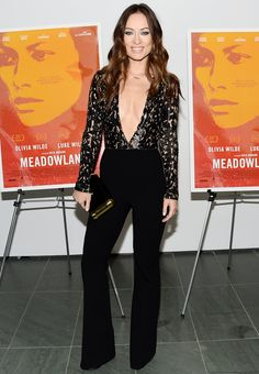 Olivia Wildechanneled the '70s in a black Michael Kors jumpsuit that showed off her toned body