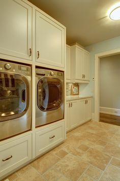When we redo the Laundry Room. This laundry room features built-in cabinets that brings the washer and dryer to a higher position, which means less back pain! Laundry Room Lighting, Laundry Room Cabinets, Basement Laundry, Laundry Room Storage, Built In Cabinets, Laundry Room Design, Laundry In Bathroom, Laundry Rooms, Small Laundry