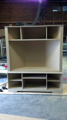 Corner entertainment center -  maybe as bookshelves on side for games and movies