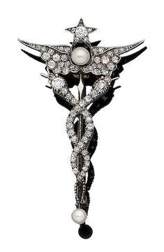 A pearl and diamond caduceus brooch