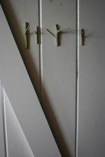 painted twig hooks -http://ofhammersandglitter.blogspot.com/