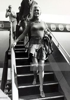 2nd September 1966, French actress Brigitte Bardot, (born 1934), arrives a London Airport dressed in a mini-skirt, Brigitte Bardot, first appeared on screen in 1952, married Roger Vadim when she was 18 and became a major star after appearing in Director Vadim's 1956 film 'And God Created Woman', She became a blond international sex symbol and sex kitten appearing in many French productions, later in the 1960's becoming popular in the USA, She retired from films in the 1970's and has devoted…