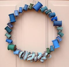 Here's a lovely painted spool wreath - you could do this in any colors for any season!