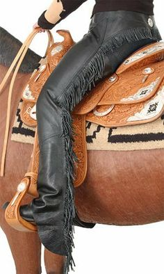 """Tough-1 Smooth Leather Show Chaps . $109.99. Top Grain Leather! Lightweight and comfortable, giving you the elegant look you demand. Quality smooth leather equitation show chaps. Adjustable buckle front belt and heavy-duty zipper. Double stitched stress points. Wrap-around rear with fringe and silver conch. Comes in Black (pictured) and Brown. Chap Measurement Chart  Extra Small Small Medium Large Extra Large Inseam 30"""" 30 ½"""" 32"""" 33""""..."""