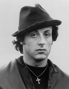 Here& Sylvester Stallone starring in the movie Rocky as the legendary fictional boxer. He& consistently seen wearing his linen fedora throughout the film which was shot in Philadelphia. Hollywood Actor, Hollywood Stars, Classic Hollywood, Famous Faces, Famous Men, Famous People, Stallone Rocky, Rocky Sylvester Stallone, Rocky Film