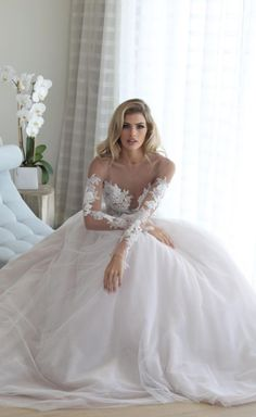 Classic lace embroidered long-sleeve illusion bodice ballgown wedding dress; Featured Dress: Erin Cole