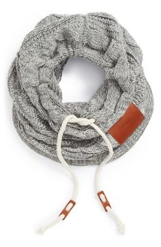 Great idea for a customer fit   Cable knit scarf with a drawstring.