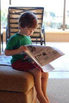 During a family vacation at Pelican Hill, the three-year-old picked up the morning paper to be like his dad.|www.pelicanhill.com |The Resort at Pelican Hill, Newport Beach, CA | #pelicanhillresort #memories