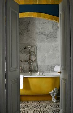Rosa Beltran Design {Blog} cement concrete encaustic tile moroccan morroccan morocco foyer floor graphic geometric entry hall entryway black walls granada moorish fez patterned clawfoot tub yellow gold claw foot bath tub bathroom bathtub