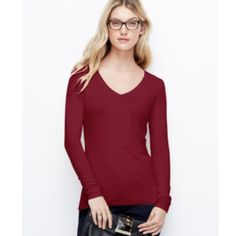 NWT Ann Taylor Long Sleeve Tee Ruby red color, v neck, long sleeves, 100% cotton. Perfect paired with jeans. No trades, discount with bundle. Fair offers welcome. Ann Taylor Tops Tees - Long Sleeve