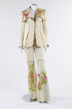 A pair of North Beach hippy-style suits, early 1970s, labelled 'Handcrafted for NBL in Pitiquito, Mexico' and signed 'painted by Kenn Fung',  of soft ivory leather painted with humming birds and roses