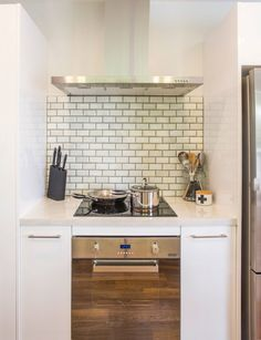 10 Kitchen And Home Decor Items Every 20 Something Needs: This Kitchen Went From Dull And Dark To Light And Bright Kitchen Interior, Kitchen Decor, Kitchen Ideas, Accent Wall In Kitchen, Small Kitchen Storage, Updated Kitchen, Modern Kitchen Design, Living Room Kitchen, Kitchen Layout