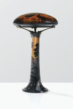 GALLÉ LAMPE AUX PAPILLONS, VERS 1906-1914 A LARGE, INTERNALLY DECORATED, HAMMERED, CAMEO GLASS LAMP, THE BASE IRIDESCENT, WITH FIRE POLISHED DETAILS, BY GALLÉ, CIRCA 1906-1914