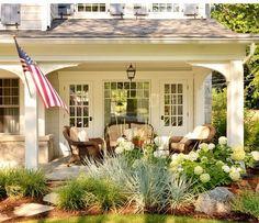 Expand front porch, lantern in center, match coach lights, idea....