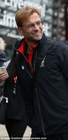 Jurgen Klopp heads for a train at Liverpool Lime Street ahead of the manager's first game