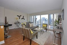 Living room in downtown Toronto condo, staged to sell for a high ROI, via Toronto's home staging company, Design to Impress!