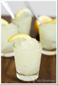 Vodka Lemonade Slush. I may have to make this today. Summer day, sun is out, thirst is never ending--oh yeah.