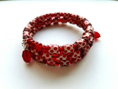 Hey, I found this really awesome Etsy listing at https://www.etsy.com/listing/471159128/memory-wire-bracelet-with-red-glass