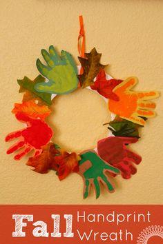 Fall handprint craft idea: A cute and colorful kids handprint wreath. | http://www.evolvingmotherhood.com