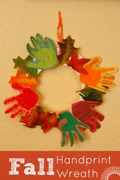 Fall handprint craft idea: A cute and colorful kids handprint wreath. | http://www.evolvingmotherhood.com