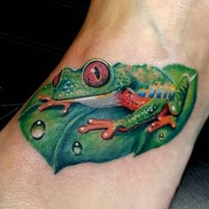 Realistic Leaf And Green Frog Tattoo On Left Foot