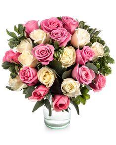 """Un buchet rafinat și feminin care va produce o bucurie imensă în momentul în care va ajunge în brațele destinatarei și o va face să simtă specială. Prin alăturarea trandafirilor albi cu cei roz, poți transmite mesajul """"Mi-e dor de tine"""" sau """"Ești minunată"""". Frumoșii trandafiri sunt puși în valoare și mai mult de verdeața decorativă ce oferă un plus de prospețime. Alege sa comanzi acest buchet delicat oriunde în România cu livrare rapida la destinatar. #roses #trandafiri #bucheteonline #flori"""