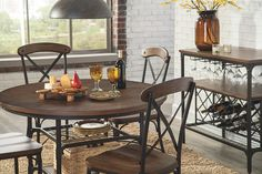vintage round wood table and chairs with metal bases for that industrial chic vibe